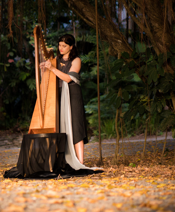 Playing harp under a fig tree